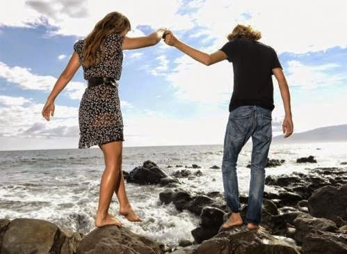 Photos of young couples are holding hands and walking on the beach