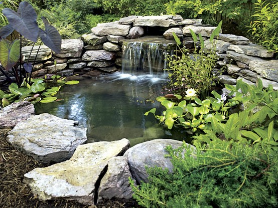Sprinkler juice how to build a backyard pond for Making a garden pond and waterfall
