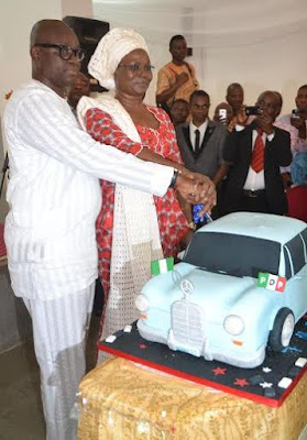 ayo fayose cuts birthday cake with wife