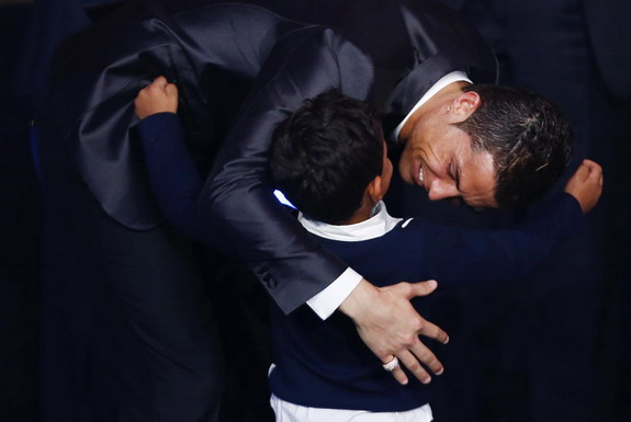 Cristiano Ronaldo embraces his son after being awarded the FIFA Ballon d'Or 2013