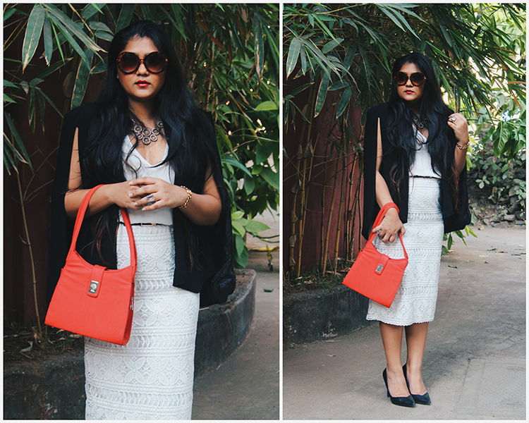 Cape blazer with white lace dress and vintage bag and sunglasses