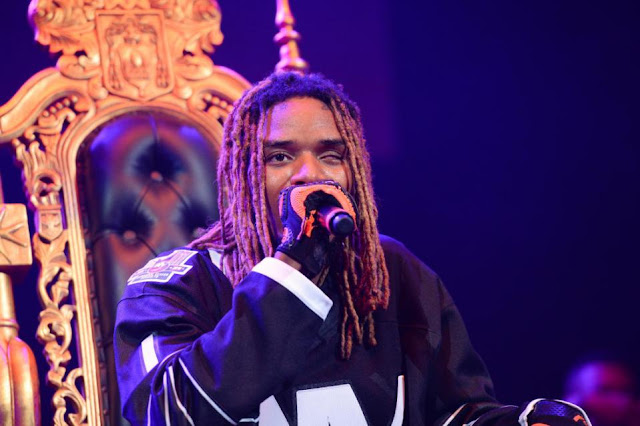 FILE - In this Oct. 22, 2015 file photo, rapper Fetty Wap performs at Power 105.1's Powerhouse 2015 at Barclays Center in New York. Fetty Wap tossed wads of cash over a balcony at a New Jersey mall to the delight of onlookers. Videos posted to social media show the Paterson, N.J., native throwing money as he walked through the Garden State Plaza mall in Paramus on Saturday, Nov. 21. The rapper posted on Twitter that he was so happy to be shopping with his daughter that he threw $2,000 to fans. (Photo by Scott Roth/Invision/AP, File)