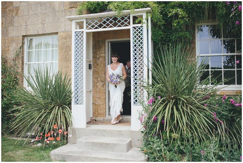 Bride leaving Crepe Farmhouse at Symondsbury before her wedding