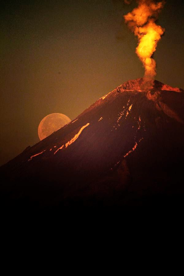 Moonrise with full moon over volcano