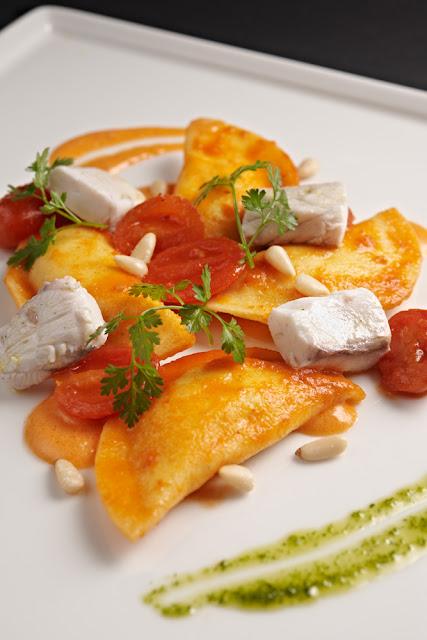 Half-moon ravioli of potatoes, ricotta and lemon served with Sea bass ...