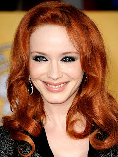 'Mad Men' star Christina Hendricks gets dressed up at home for her husband