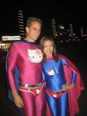 Hello Kitty superheroes - superhero costume man and woman couple
