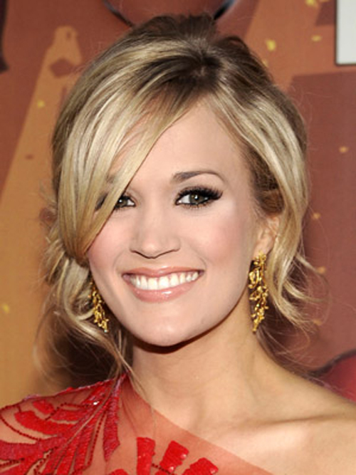 Carrie Underwood adds a twist to her side bun with loose, face-framing pieces.
