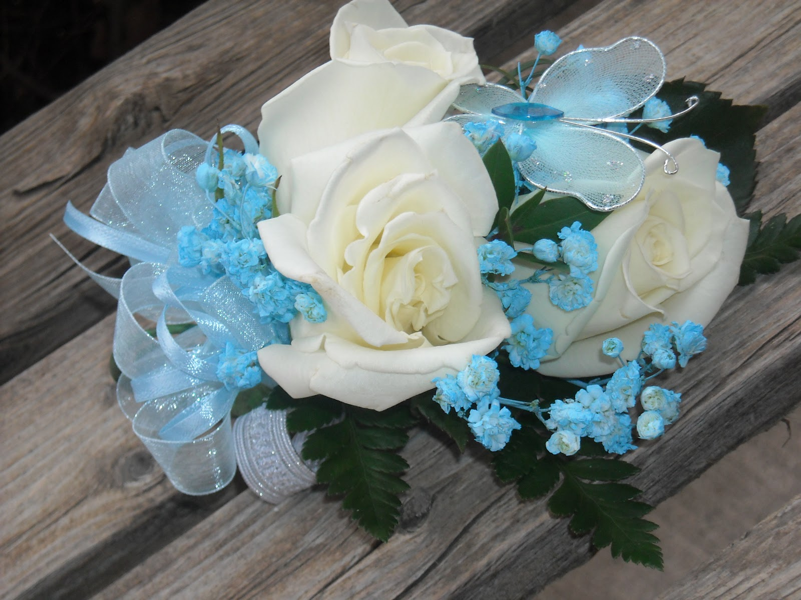 Triple White Rose Wristlet Corsage With Baby Blue Sprayed Babyu0027s Breath And  A Blue Butterfly With Matching Ribbon
