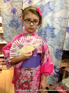 Very Young Girl wearing a childrens Japanese Robe Kimono