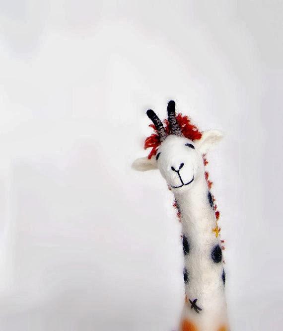 http://www.etsy.com/listing/101047060/claudia-felt-giraffe-art-puppet