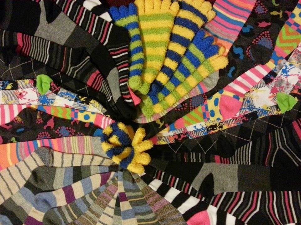 Socks in a variety of colors and patterns arranged in spiral pattern