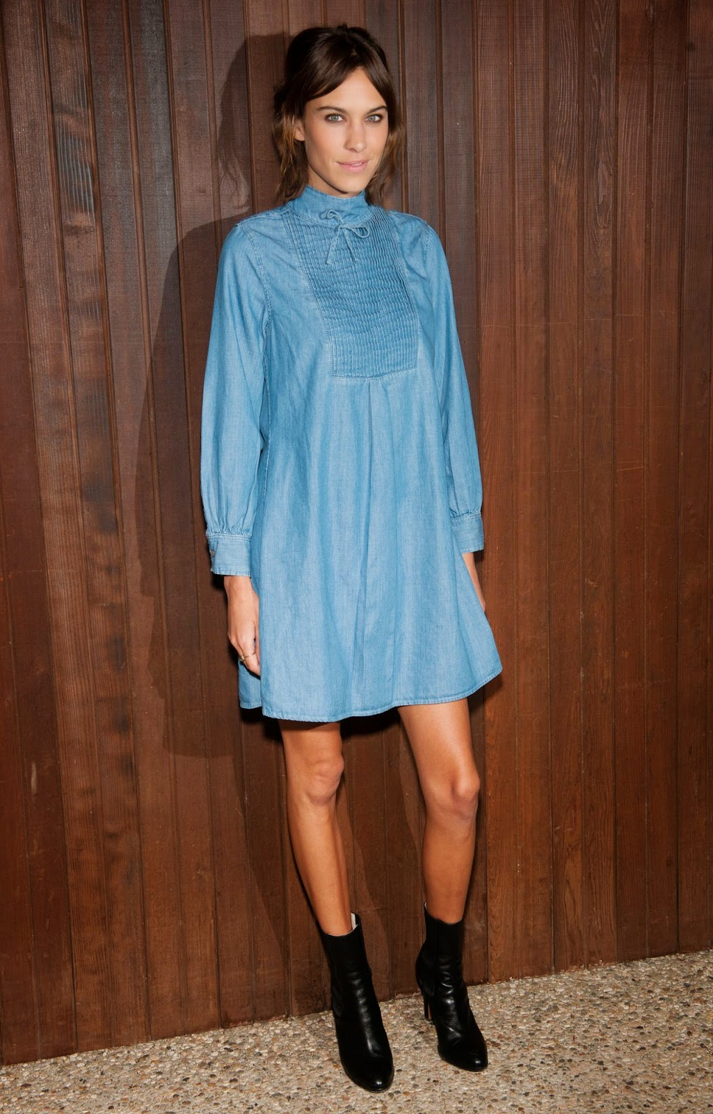 Alexa Chung in a denim baby doll dress at the Alexa Chung for AG launch party in Beverly Hills