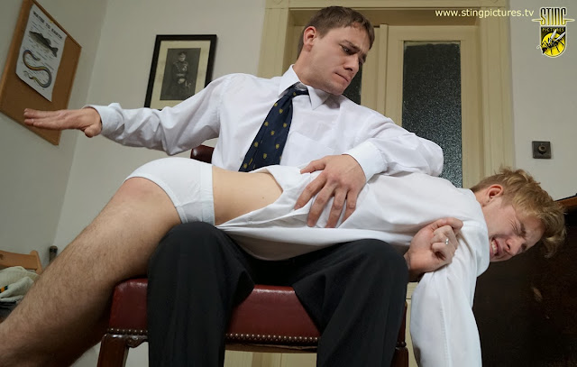 Boy spanked over the knee