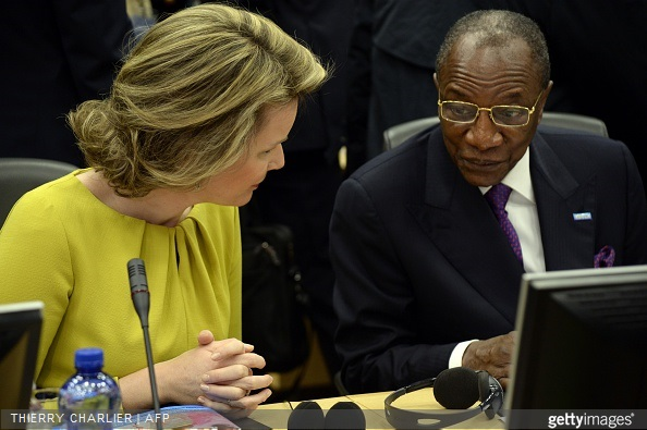 Queen Mathilde of Belgium talks with Guinean President Alpha Conde during a conference on Ebola