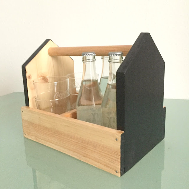 http://labuhardilla.bigcartel.com/product/portabotellas-black-and-wood