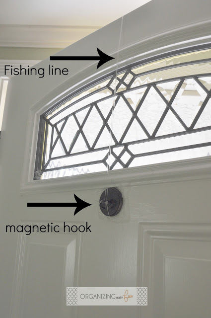 Use fishing line and a hook on the back of the door to hang wreath :: OrganizingMadeFun.com