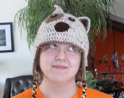 woman wearing crocheted dug hat