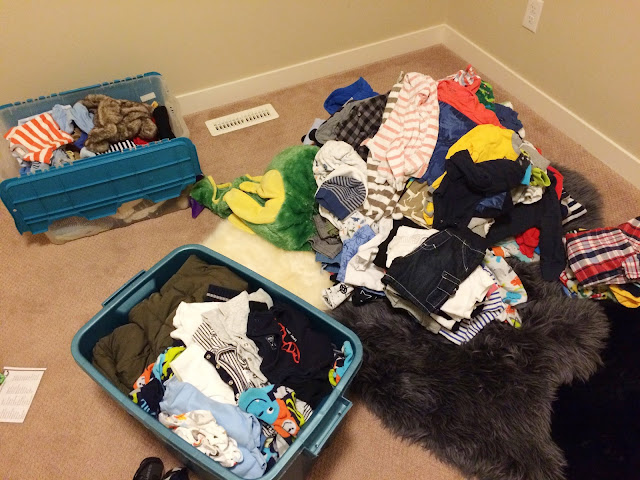 sorting baby clothes