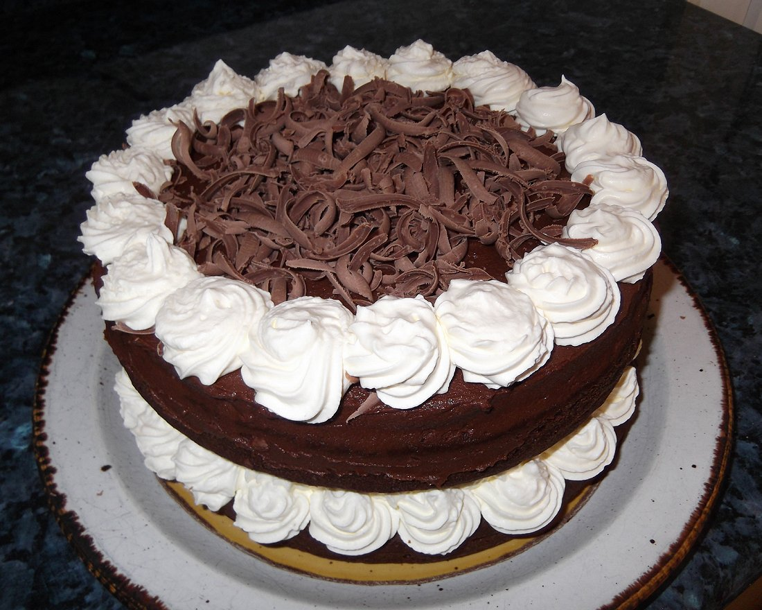 Decorating A Cake With Grated Chocolate