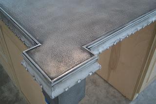 Happy habitat think zinc an alternative for Zinc kitchen countertop