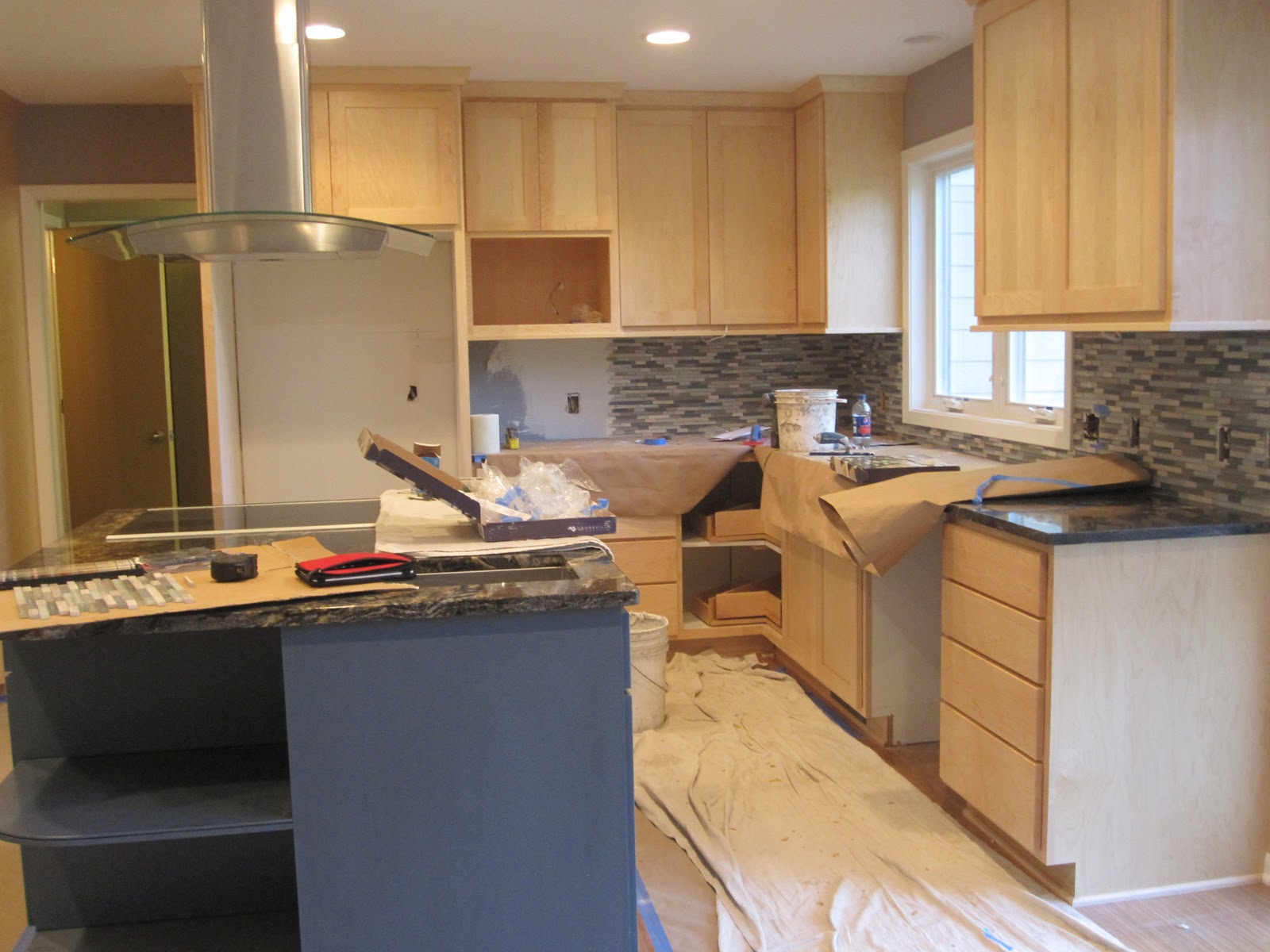 Larger view of kitchen showing maple cabinetry, new tile mosaic