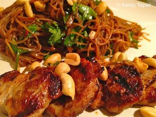 Noodle salad with pork: pork, rice noodles, coriander, soy sauce, honey, peanuts, lime