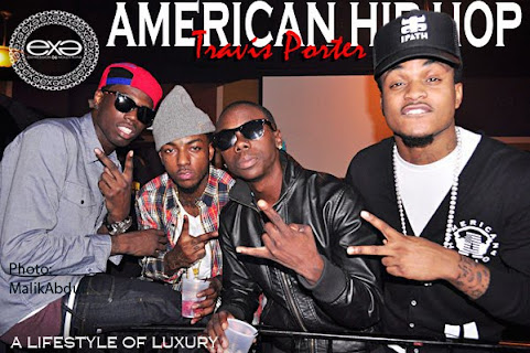"A MEMBER OF ""TRAVIS PORTER"" WEARING EX.E AMERICAN HIP-HOP CARDIGAN"