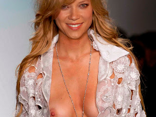 Amy Smart topless on the catwalk show nice tits