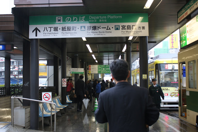 Heading to the platform of Streetcar (Hiroshima Electric Railway) Station which is located outside of Hiroshima Train Station in Japan
