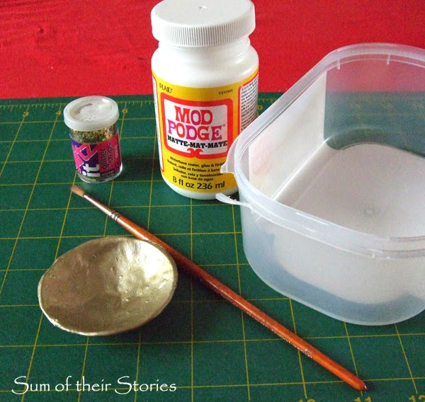 glitter to dish with mod podge