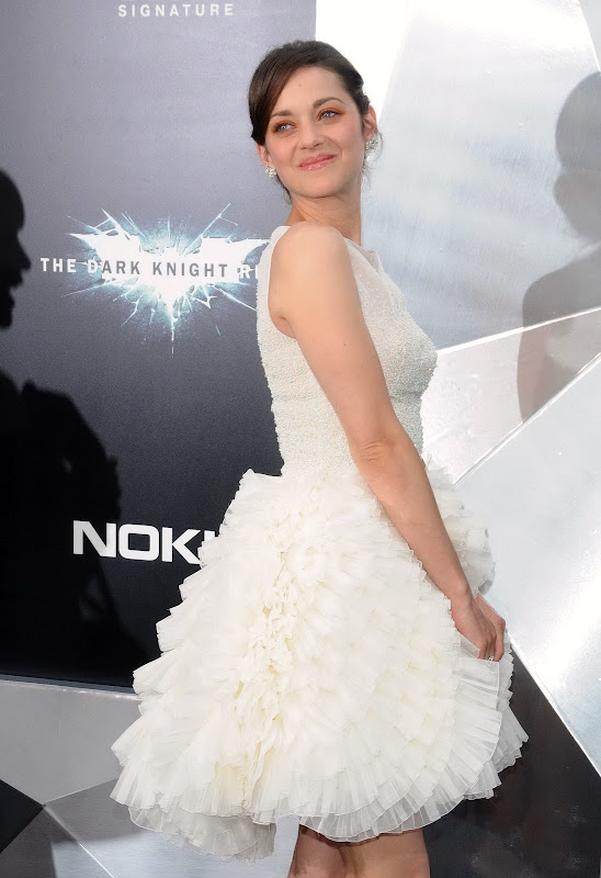 Marion Cotillard in a white dress at The Dark Knight Rises  New York premiere