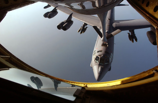 A B-52 Stratofortress receives fuel from a KC-135 Stratotanker over the Indian Ocean.