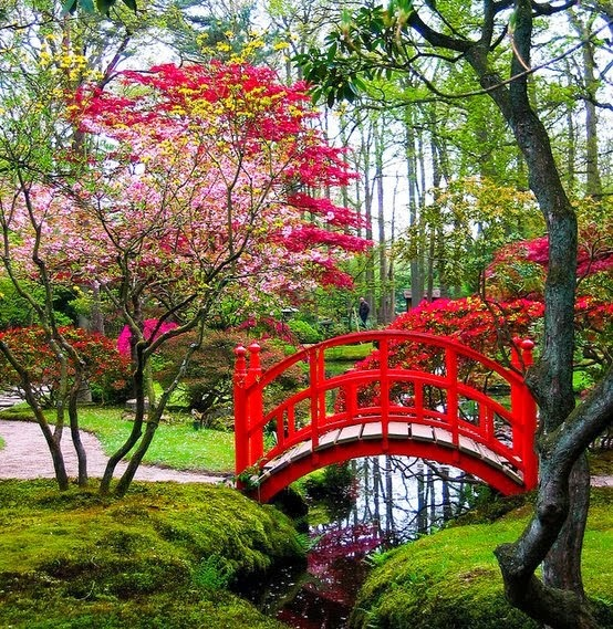 Japanese garden with a lovely red bridge over a small stream for Japanese garden pond bridge
