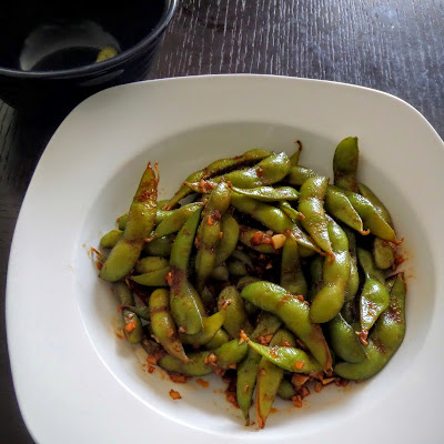 Spicy Edamame:  Young soybeans, in the pod, sauteed in ginger, garlic, soy sauce, and sriracha.  A spicy, salty, and nutritious snack.