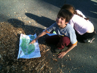 little boy pointing to a map