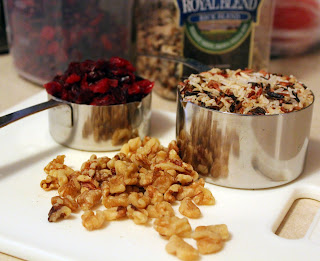 Ingredients for wild rice with dried cranberries and walnuts.