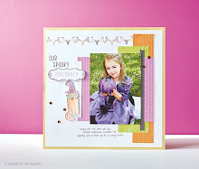Aug.  Stamp of the Month scrapbook layout