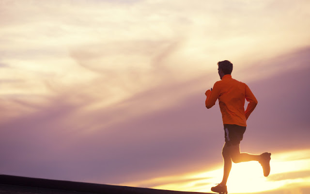 Image:  Man running over the horizon in front of a purple and gold skyline.  My NTCC:  You don't heal by running away from your problems.  In order to truly move on, you must examine and deal with each item.  Take time to heal.