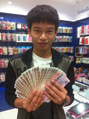 thai boy with money