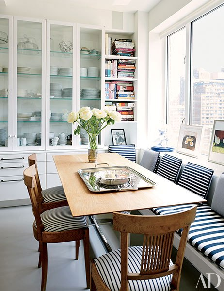 """""""Upholstered in a Rogers and Goffigon ticking, a set of 18th-century Swedish chairs from Laurin Copen Antiques graces one corner of the kitchen."""" Greenwich Village home of designer Isaac Mizrahi and his husband Arnold Germer. Renovation architect: David Bers. Photography by Jason Schmidt."""