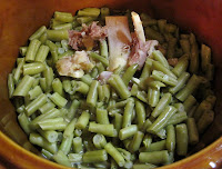 Crock pot recipe for spicy green beens with ham hock