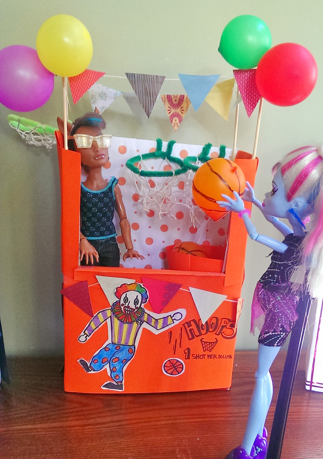 Craft a doll carnival booth from cereal boxes