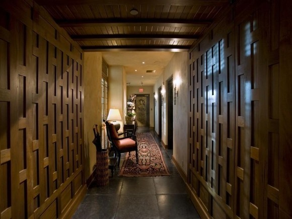 Photo of hallway with wooden walls and ceiling