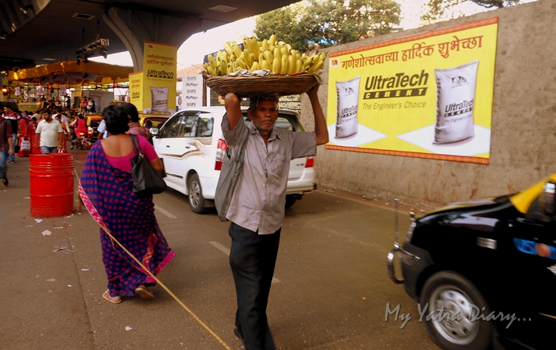 A shopkeeper on the way to Lalbaugcha raja, Ganesh Pandal Hopping, Mumbai