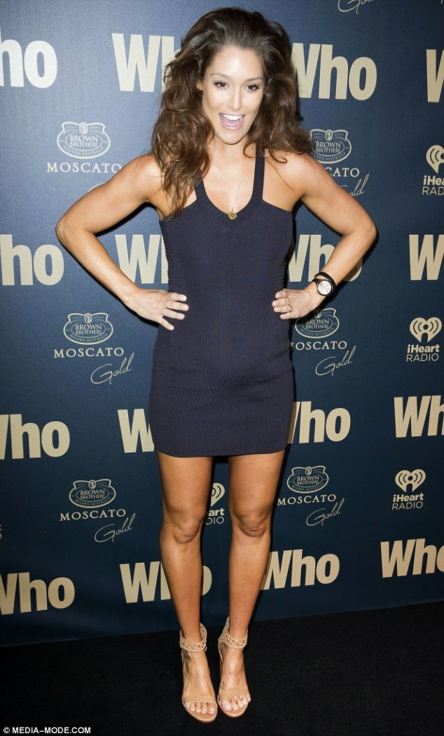 Photographed at Who's Sexiest People party recently, Erin wore a navy  body-con mini dress with nude platform shoes.