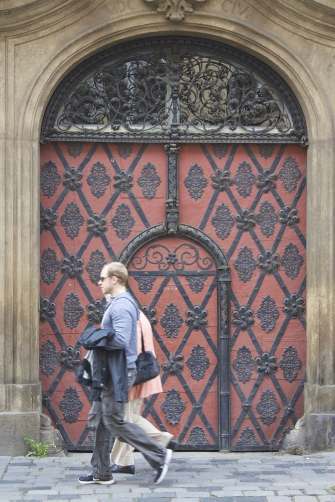 red door with passersby