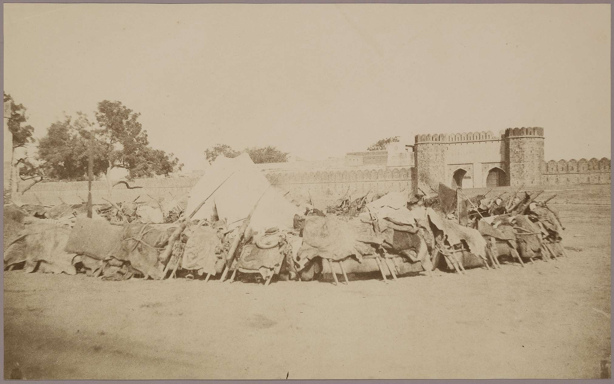 Lahore Gate of Delhi with Patiala Raja's Zumbruck (Camel Gun Encampment) - c.1857-1858