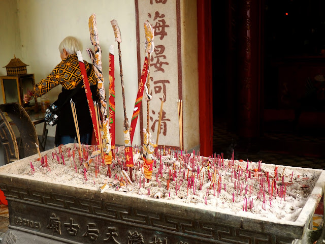 Incense sticks and prayer outside Tin Hau Temple, Yung Shue Wan, Lamma Island, Hong Kong