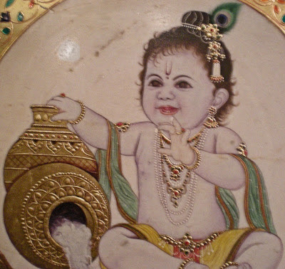 Vishnu, Indian god, baby, toddler, golden jars, white substance, shaving soap